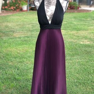 Betsy & Adam Size 4 pleated purple and black gown